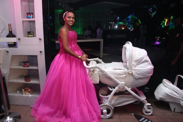 DJ Pierra holding her Versace stroller