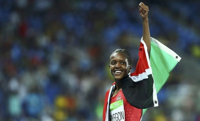 2016 Rio Olympics - Athletics - Final - Women's 1500m Final - Olympic Stadium - Rio de Janeiro, Brazil - 16/08/2016. Faith Chepngetich Kipyegon (KEN) of Kenya celebrates winning the gold. REUTERS/Lucy Nicholson FOR EDITORIAL USE ONLY. NOT FOR SALE FOR MARKETING OR ADVERTISING CAMPAIGNS.