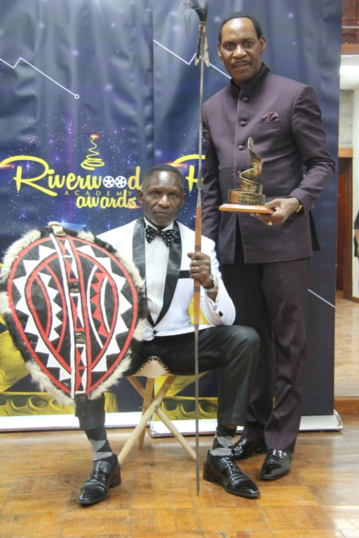 Lifetime Archievement Award winner Raymond Ofula and Kenya Film Classification Board CEO Ezekiel Mutua.