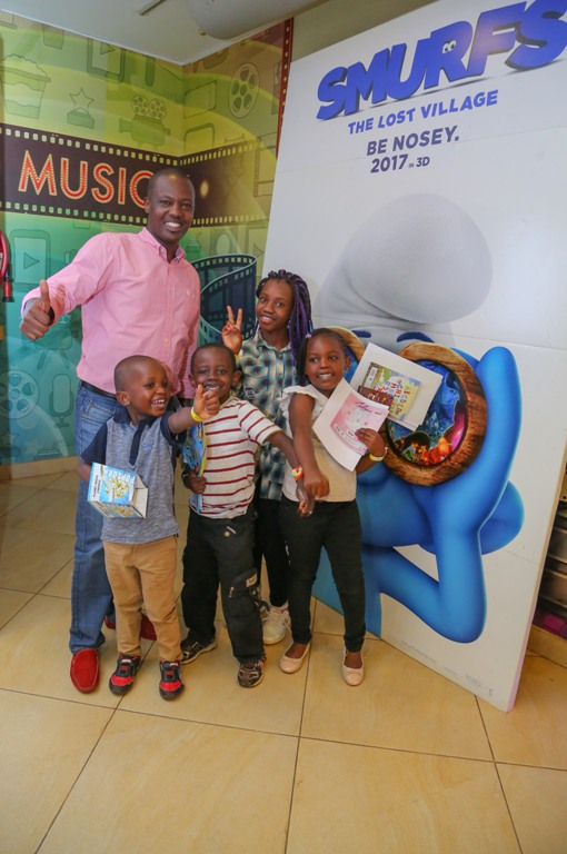 Multichoice Corporate Affairs Manager, Philip Wahome with kids.