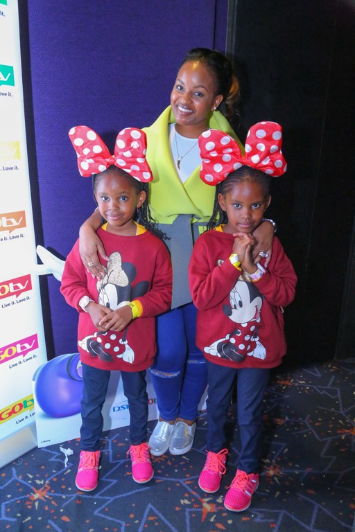 Radio Africa's, Grace Msalame with her twin daughters, Zawadi and Raha.