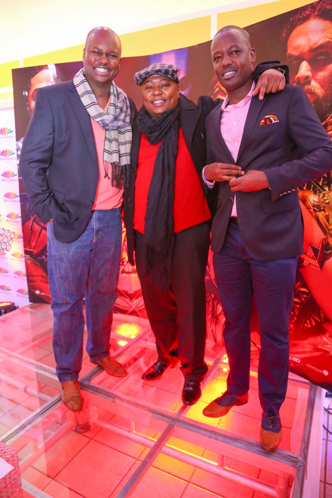 Multichoice Corporate Affairs Manager, Philip Wahome (R), with Capital FM Presenter, Macbul Mohammed (L) and didge.