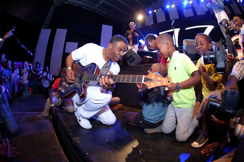 US based jazz star Brown Norman enjoys playing guitar to young jazz fans during the Safaricom International Jazz festival.