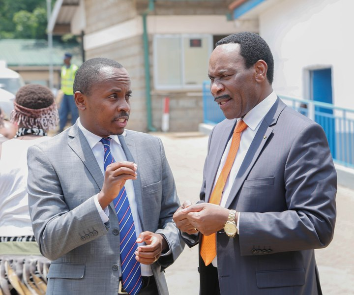 Kenya Film Classification Board CEO, Dr. Ezekiel Mutua (right) interacts with MP Dagoretti South, John Kiarie (left) during the Multichoice Talent Factory Academy launch at Local Productions facility.