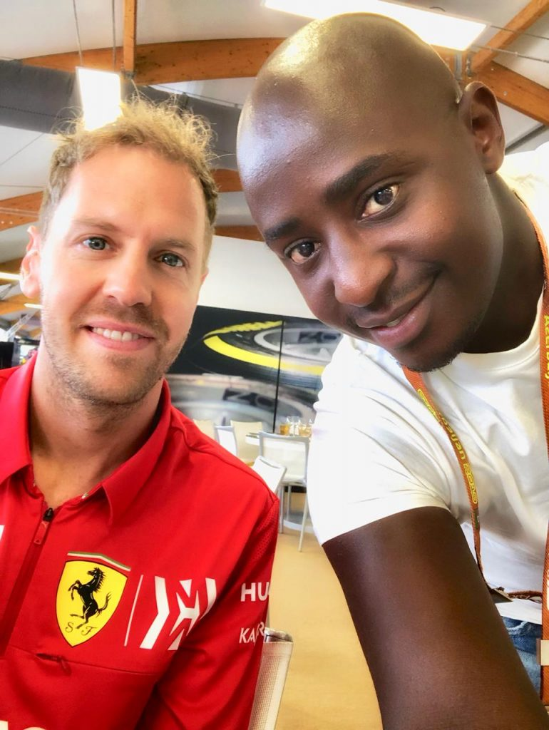 F1 driver Sebastian Vettel and Patrick Githinji of Redhouse.